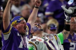 Minnesota Vikings fans celebrate during the second half of an NFL football game against the Green Bay Packers Sunday, Sept. 18, 2016, in Minneapolis. The Vikings won 17-14. (AP Photo/Andy Clayton-King)
