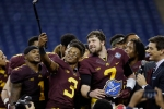 Minnesota defensive back KiAnte Hardin (3) takes a photo with quarterback Mitch Leidner (7) after their Quick Lane Bowl NCAA college football game against Central Michigan, Monday, Dec. 28, 2015, in Detroit. Minnesota defeated Central Michigan 21-14. (AP Photo/Carlos Osorio)