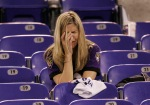 Baltimore fan Lisa Scheuerman cries in the stands after the AFC divisional playoff football game in Baltimore Saturday, Jan. 13, 2007.  The Baltimore Ravens were defeated by the Indianapolis Colts, 15 - 6. (AP Photo/Chris Gardner)