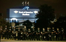 Police officers block the access road to I-277 near Bank of America Stadium on the third night of protests  in Charlotte, N.C. Thursday, Sept. 22, 2016, following Tuesday's fatal police shooting of Keith Lamont Scott in Charlotte, N.C. (AP Photo/Chuck Burton)