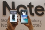 FILE - In this Thursday, Aug. 11, 2016, file photo, models display the iris scanner features of the Samsung Galaxy Note 7 smartphones during its launch event at the company's headquarter in Seoul, South Korea. Samsung on Thursday, Sept. 1, 2016, has delayed shipments of Galaxy Note 7 smartphones in South Korea for quality control testing after reports that batteries in some of the jumbo smartphones exploded while they were being charged. (AP Photo/Ahn Young-joon. File)