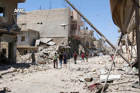 In this Wednesday, July. 27, 2016 photo, provided by the Syrian anti-government activist group Aleppo Media Center (AMC), shows Syrian citizens inspect damaged buildings after airstrikes hit Aleppo, Syria. Residents trapped in rebel-controlled Aleppo are struggling to survive the crippling encirclement of their once thriving city. Bread, medication and fuel are running short. For the tens of thousands who chose to remain, the battle for Aleppo is a pivot point in the Syrian war. (Aleppo Media Center via AP)