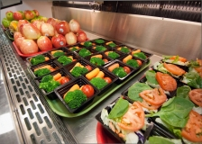 Healthy choices of fresh fruit, salads and vegetables at Washington-Lee High School in Arlington, Virginia for lunch service Wednesday, October 19, 2011. The fruit, salads and vegetables are made available through the National School Lunch Program. The National School Lunch Program is a federally assisted meal program administered by the United States Department of Agriculture, Food and Nutrition Service operating in public, nonprofit private schools and residential child care institutions. It provides nutritionally balanced, low-cost or free lunches to children each school day.